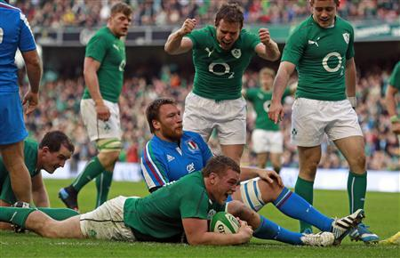 Ireland's McGrath celebrates scoring a try against Italy in their Six Nations rugby union match at Aviva stadium in Dublin