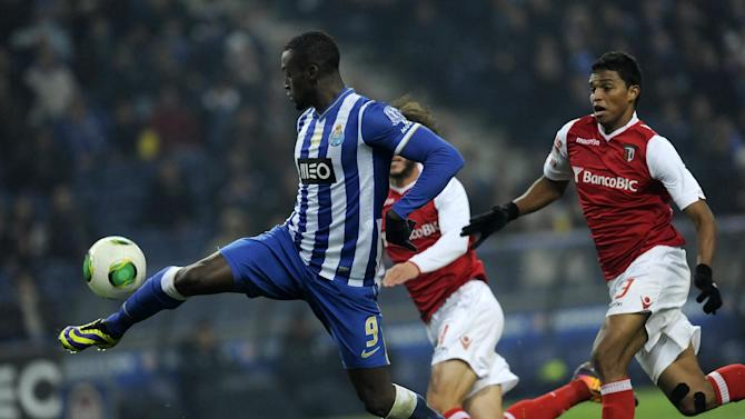 FC Porto's Jackson Martinez, left, from Colombia controls the ball past Sporting Braga's Aderlan Santos, from Brazil, in a Portuguese League soccer match at the Dragao Stadium in Porto, Portugal, Saturday, Dec. 7, 2013. Jackson scored twice in Porto's 2-0 victory