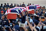 Malaysian police carry the coffins of two dead officers killed in an ambush in Semporna, at the Subang Royal Malaysian Air Force base in Kuala Lumpur on March 4, 2013. A total of 27 people have been reported killed since the militants landed on February 12 in the state of Sabah on Borneo island by boat and claimed the state on behalf of the heir to a now-defunct Philippine Islamic sultanate