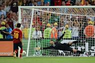 Spanish midfielder Cesc Fabregas (L) scores the winning penalty despite Portuguese goalkeeper Rui Patricio during the penalty shoot out of the Euro 2012 football championships semi-final match Portugal vs. Spain at the Donbass Arena in Donetsk