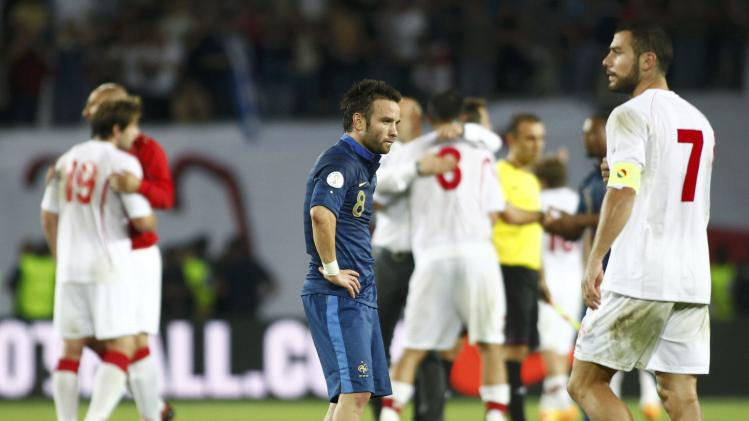 France's Mathieu Valbuena looks on as Georgia's Jaba Kankava passes by after the 2014 World Cup qualifying soccer match at the Boris Paichadze National Stadium in Tbilisi