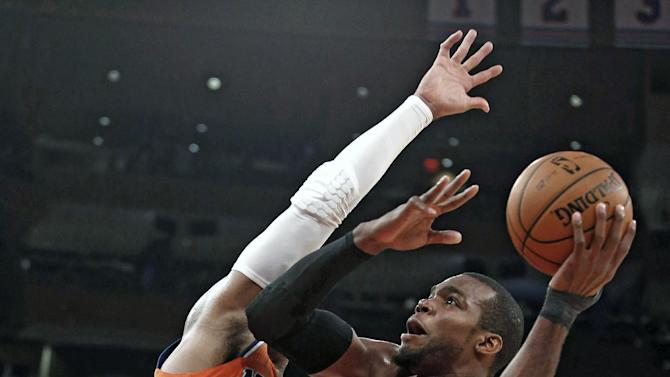 Atlanta Hawks' Paul Millsap (4) shoots against New York Knicks' Carmelo Anthony (7) during the second half of an NBA basketball game Saturday, Nov. 16, 2013, in New York.  Atlanta defeated New York 110-90