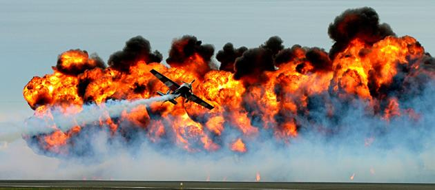 The Tinstix of Dynamite team performs in front of a massive wall of fire at the Melbourne International Airshow. The team mix dangerous flying techniques with dramatic fire displays to put on an explo