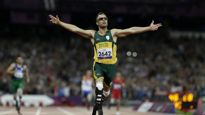 South Africa's Oscar Pistorius wins gold in the men's 400-meter T44 final at the 2012 Paralympics, Saturday, Sept. 8, 2012, in London. (AP Photo/Kirsty Wigglesworth)