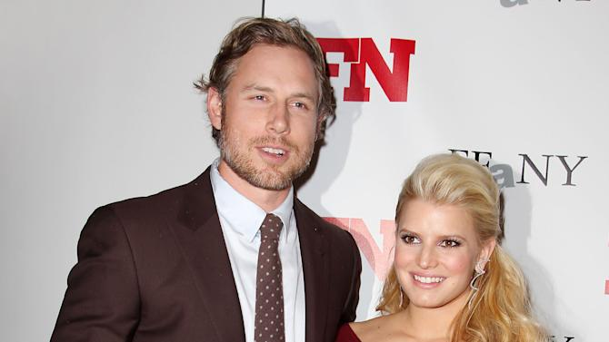 FILE - In this Nov. 29, 2011 file photo, singer Jessica Simpson, right, poses with Eric Johnson at the 25th Annual Footwear News Achievement Awards at The Museum of Modern Art in New York. Simpson's rep confirmed that the entertainer gave birth to Ace Knute in Los Angeles on Sunday, June 30, 2013, via planned C-section. This is the second child for Simpson and her fiance, Eric Johnson. Simpson gave birth to daughter Maxwell last year. (AP Photo/Starpix, Amanda Schwab, file)