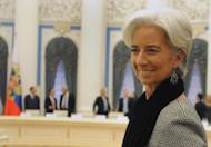 "International Monetary Fund Managing Director Christine Lagarde waits for Russian President Vladimir Putin during a meeting of G20 finance ministers in the Kremlin in Moscow on February 15, 2013. G20 finance ministers moved to calm fears of looming ""economic warfare"" on the currency markets, pledging they would not target specific forex rates or devalue currencies to make them more competitive"