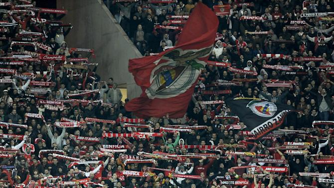 Benfica supporters hold up scarfs on the stands during a Portugal Cup semifinal first leg soccer match against FC Porto at the Dragao stadium in Porto, Portugal, Wednesday, March 26, 2014. Porto won 1-0
