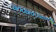 "The headquarters of Standard Chartered Bank in London, pictured in August. British bank Standard Chartered said on Thursday it expects to pay around $330 million to settle with US authorities ""very shortly"" over allegations it violated sanctions on Iran"