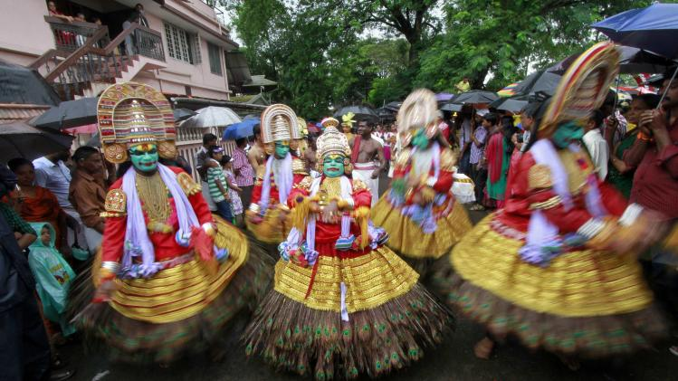 Dancers perform as they take part in festivities marking the start of the annual harvest festival of Onam in Kochi