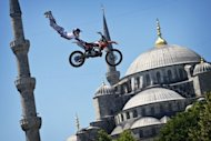 A biker performs a demo jump in front of the Blue Mosque in Istanbul on June 13, 2012. Istanbul's Olympic bid believes it can prevail at the fifth attempt -- though this is the first realistic chance it has had of winning -- with the government wanting to prioritise the Olympics rather than a bid for the Euro 2020 football championships