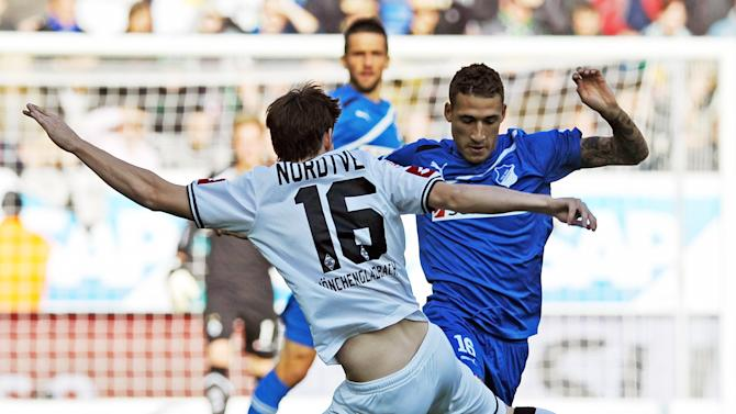 FILE - In this Oct. 22, 2011, file photo, Hoffenheim's Fabian Johnson, right, challenges for the ball with Moenchengladbach's Havard Nordtveit during a German Bundesliga soccer match in Sinsheim, southern Germany. Two years ago, Johnson was starting for Germany in the final of the European Under-21 Championship. On Friday, the 23-year-old midfielder could make his debut for the U.S. national team in an exhibition game against France. (AP Photo/dapd, Ronald Wittek, File)