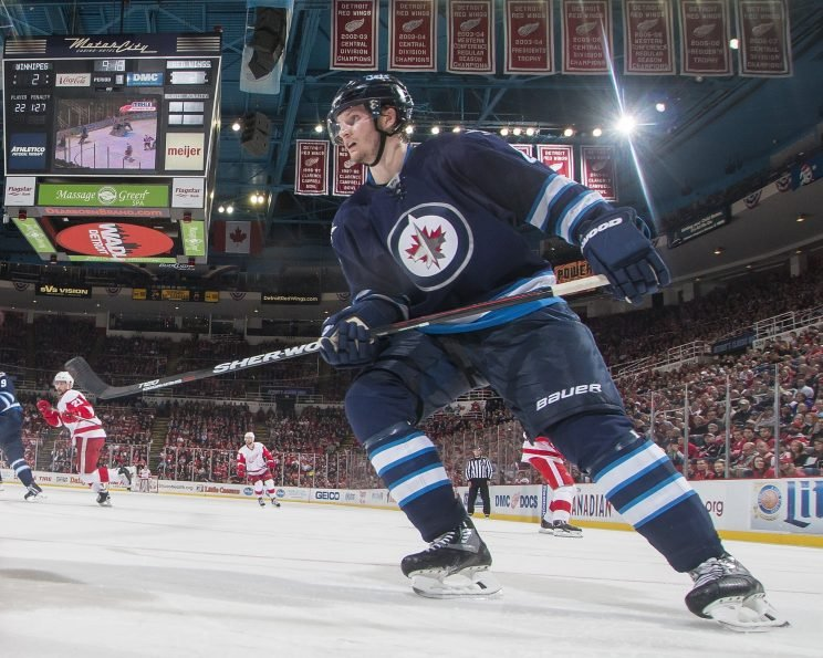 DETROIT, MI - MARCH 10: Jacob Trouba #8 of the Winnipeg Jets follows the play during an NHL game against the Detroit Red Wings at Joe Louis Arena on March 10, 2016 in Detroit, Michigan. The Wings defeated the Winnipeg Jets 3-2. (Photo by Dave Reginek/NHLI via Getty Images)
