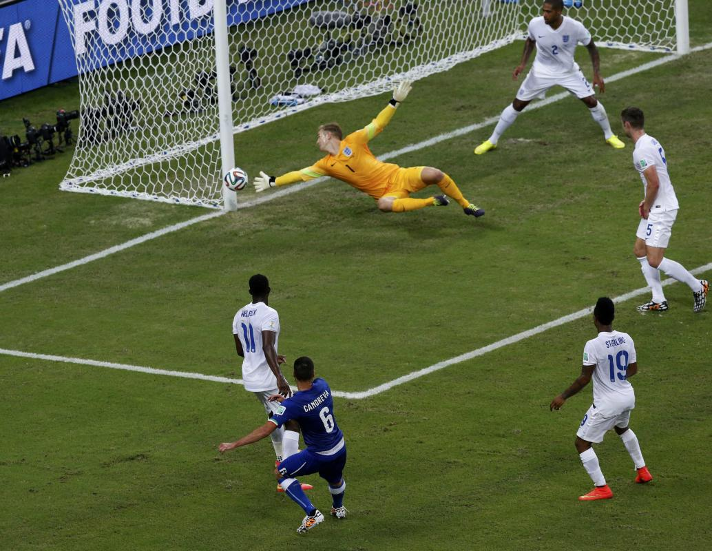 England's goalkeeper Joe Hart saves the ball during the 2014 World Cup Group D soccer match between England and Italy at the Amazonia arena in...