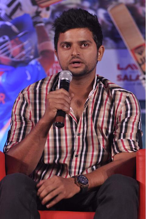 Indian Cricket player Suresh Raina during the Salute Sachin marathon broadcast by Aaj Tak Nehru Center in Mumbai on November 12, 2013. (Photo: IANS)