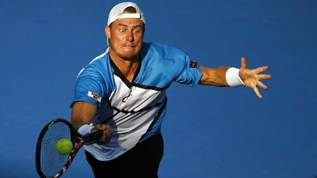 Lleyton Hewitt en route to victory against Roger Federer in Brisbane