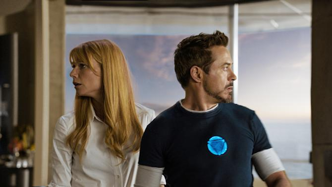 "This undated publicity photo released by Marvel shows Gwyneth Paltrow, left, as Pepper Potts, and Robert Downey Jr., as Tony Stark/Iron Man, in a scene from Marvel's ""Iron Man 3."" The movie releases in the USA on May 3, 2013. (AP Photo/Marvel, Film Frame)"