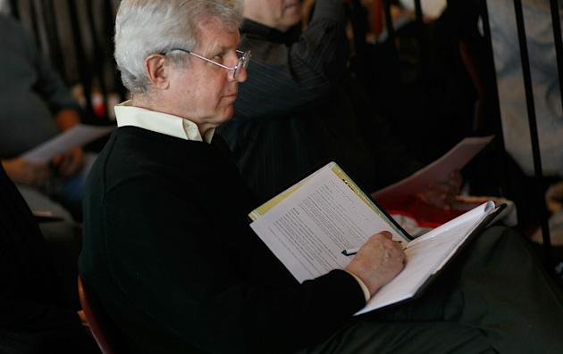 "NEW YORK, NY - JANUARY 18: An older job-seeker takes notes during an employment seminar at a ""Work Search"" event aimed at older unemployed people January 18, 2011 at a high school gymnasium in the Harlem neighborhood of New York City. The event, sponsored by the American Association of Retired Persons (AARP), consisted of workshops for basic job skills like resume building targeted to an over-50 job seeking demographic. Unemployment for older worker has decreased slightly in the past year, though rates are still three times higher than they were a decade ago, when only 2.5 percent of people over 45 were jobless. (Photo by Chris Hondros/Getty Images)"