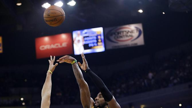 Cleveland Cavaliers guard Kyrie Irving (2) shoots over Golden State Warriors guard Stephen Curry (30) during the first half of an NBA basketball game on Friday, March 14, 2014, in Oakland, Calif