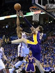 Oklahoma City Thunder's Russell Westbrook shoots as Los Angeles Lakers' Pau Gasol defends during game one of the NBA Western Conference series on May 14. Oklahoma City won 119-90