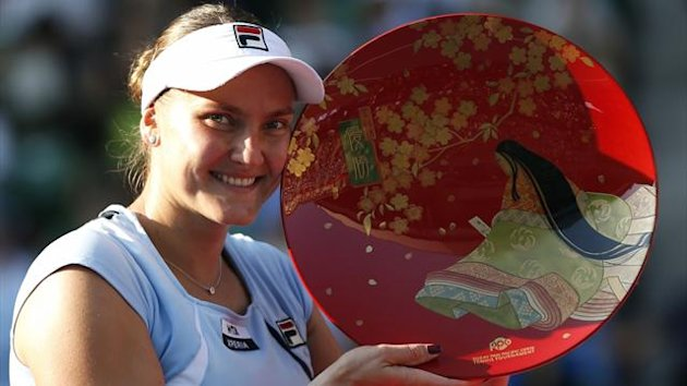 Nadia Petrova of Russia poses with her victory trophy after defeating Agnieszka Radwanska of Poland in their final match at the Pan Pacific Open tennis tournament in Tokyo (Reuters)
