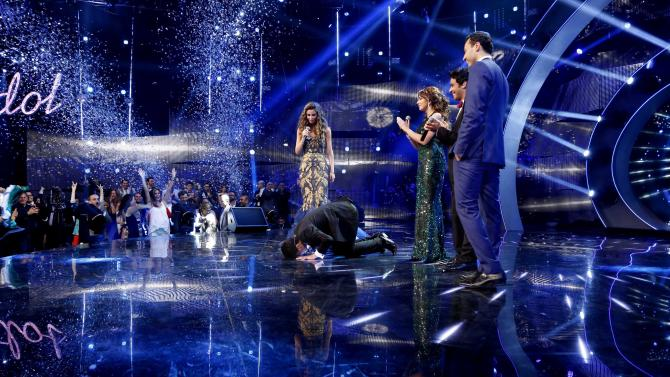 In this Saturday, June 22, 2013 photo released by the MBC Group, singer Mohammed Assaf, prays after receiving the Arab Idol award in Beirut, Lebanon. On Saturday night, Assaf became the first Palestinian to win the Arab world's version of American Idol, setting off wild celebrations across the Palestinian territories. After the victory, Palestinian President Mahmoud Abbas declared the singer an honorary ambassador. (AP Photo/MBC Group)