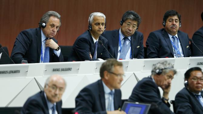 FIFA Executive Committee members listen to FIFA President Blatter at the 65th FIFA Congress in Zurich
