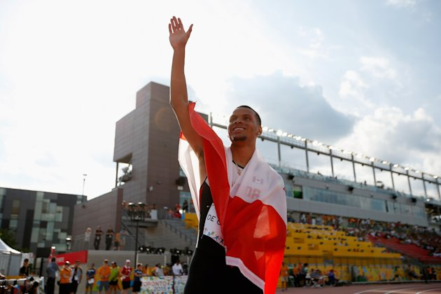 Andre De Grasse of Canada holds the Canadian flag after winning the men's 200 meter final on Day 14.  (Photo by Ezra Shaw/Getty Images)