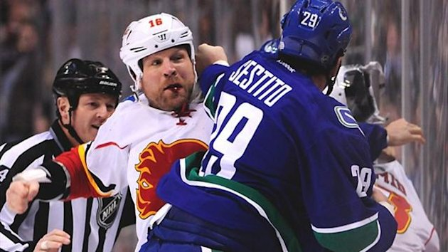 Calgary Flames forward Brian McGrattan (16) and Vancouver Canucks forward Tom Sestito (29) fight in the first two seconds of the first period at Rogers Arena (Reuters)