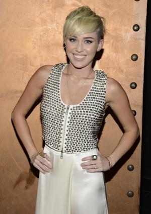 Miley Cyrus is all smiles at the City Of Hope Honors Halston CEO Ben Malka With Spirit Of Life Award - Red Carpet at Exchange LA in Los Angeles on October 10, 2012  -- Getty Images