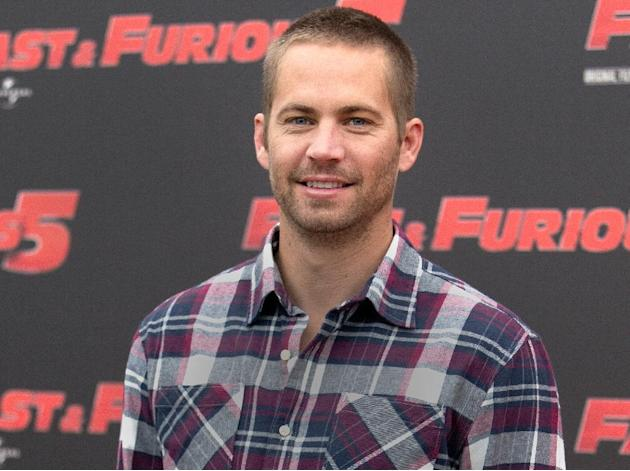 "FILE - In this April 29, 2011, file photo, actor Paul Walker poses during the photo call of the movie ""Fast and Furious 5,"" in Rome. Walker's father sued Porsche on Wednesday, Nov. 25, 2"