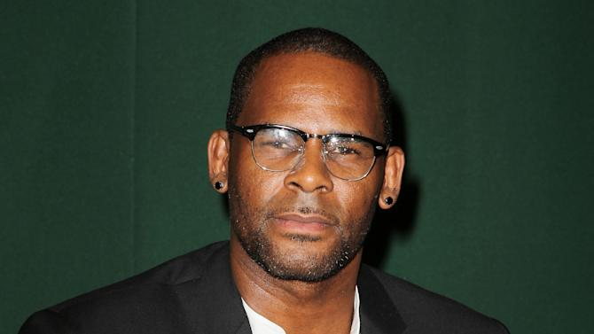 "FILE - This Aug. 10, 2012 photo originally released by Starpix shows R&B singer R. Kelly signing copies of his memoir, ""Soulacoaster: The Diary of Me,"" at Barnes & Noble in New York. R. Kelly has been all about romance on his last two albums, but the self-proclaimed Pied Piper of R&B says he isn't going to abandon the raunch that helped make him famous. Kelly's recent ""Write Me Back"" and 2010's ""Love Letter"" was a departure of sorts for the singer-songwriter, whose hits include classics like ""Your Body's Calling.""  Kelly described those acclaimed albums as a way of taking a break from his typical explicit material to try something new. (AP Photo/Starpix, Amanda Schwab, file)"