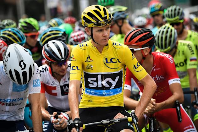 Britain's Christopher Froome (C), wearing the overall leader's yellow jersey, waits for the start of the 19th stage of the Tour de France on July 22, 2016