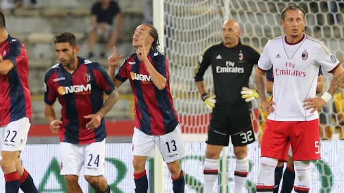 Bologna midfielder Diego Laxalt, of Uruguay, center, celebrates after scoring during the Serie A soccer match between Bologna and Milan, at Bologna's Renato Dall'Ara stadium, Italy, Wednesday, Sept. 25, 2013
