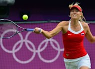Russia's Maria Sharapova returns the ball to American Serena Williams during their London 2012 Olympic Games women's singles gold medal match, at the All England Tennis Club in Wimbledon, southwest London. Williams won 6-0, 6-1
