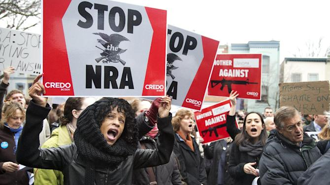 Tasha Devoe, left, of Lawrence, Mass., joins a march to the National Rifle Association headquarters on Capitol Hill in Washington Monday, Dec. 17, 2012.  Curbing gun violence will be a top priority of President Barack Obama's second term, aides say. but exactly what he'll pursue and how quickly are still evolving.   (AP Photo/Manuel Balce Ceneta)
