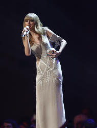 US singer Taylor Swift holds her award during the 2012 MTV European Music Awards show at the Festhalle in Frankfurt, central Germany, Sunday, Nov. 11, 2012. (AP Photo/Michael Probst)