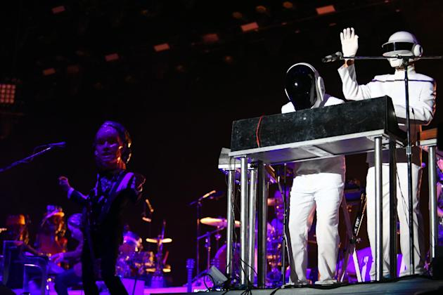 Daft Punk impersonators perform with Arcade Fire at the 2014 Coachella Music and Arts Festival on Sunday, April 20, 2014, in Indio, Calif. (Photo by Zach Cordner/Invision/AP)