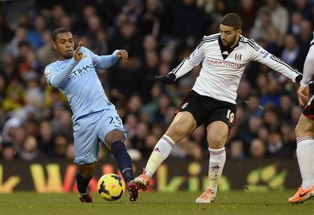 Fulham's Taarabt is challenged by Manchester City's Fernandinho during their English Premier League soccer match at Craven Cottage