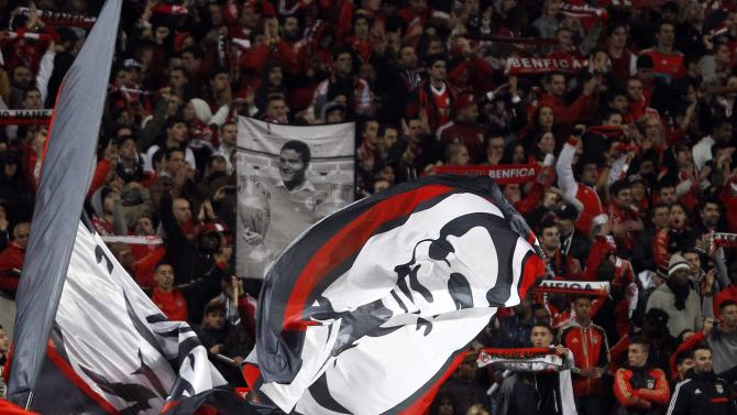 Benfica's supporters hold banners and pictures of former Portuguese legend Eusebio during their Portuguese Premier League soccer match against Porto at Luz stadium in Lisbon