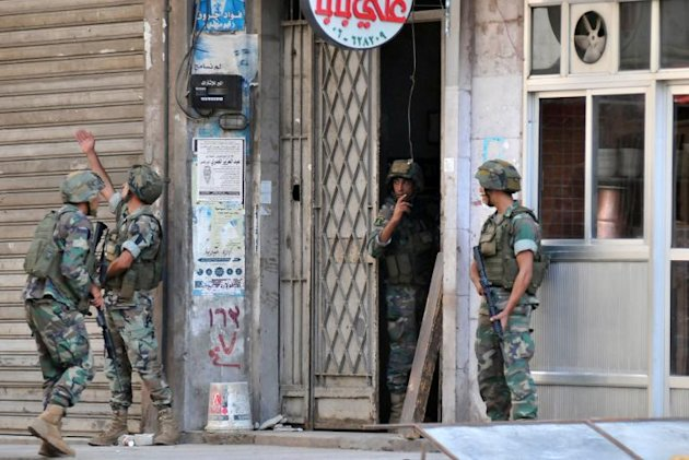 Lebanese soldiers raid an apartment in Lebanon's northern port city of Tripoli, on October 26, 2014