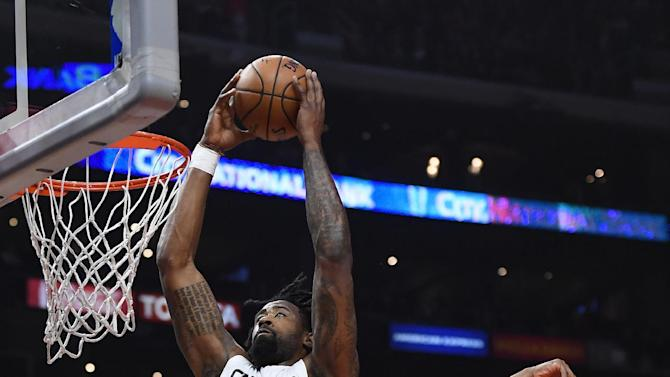 Los Angeles Clippers center DeAndre Jordan, left, dunks as Charlotte Hornets guard Kemba Walker defends during the first half of an NBA basketball game, Sunday, Feb. 26, 2017, in Los Angeles. (AP Photo/Mark J. Terrill)