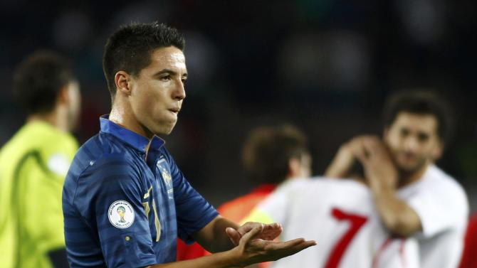 France's Samir Nasri reacts after the 2014 World Cup qualifying soccer match against Georgia at the Boris Paichadze National Stadium in Tbilisi