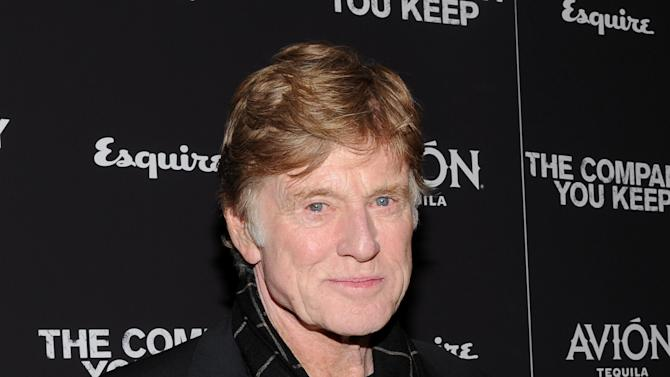 """FILE - This April 1, 2013 file photo shows director and actor Robert Redford at the premiere of """"The Company You Keep"""" at The Museum of Modern Art in New York. CNN is planning an unscripted series about Chicago that will be executive-produced by Robert Redford. The eight-part series, """"Chicagoland,"""" will premiere in 2014.  (Photo by Evan Agostini/Invision/AP, file)"""