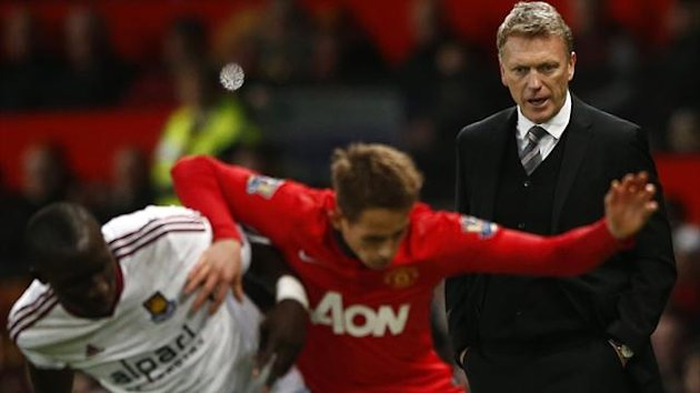Manchester United's manager David Moyes (R) reacts during their English Premier League match against West Ham (Reuters)