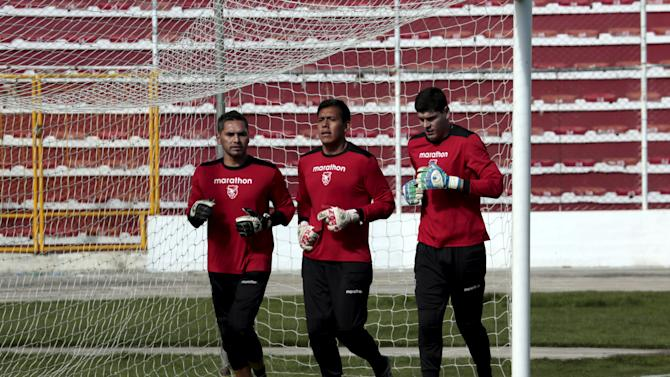 Goalkeepers Daniel Vaca, Gustavo Salvatierra and Carlos Lampe of Bolivia's national soccer team jog during a training session in La Paz