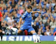 Chelsea's midfielder Edin Hazard scores a penalty during their English Premier League football match between against Newcastle United at Stamford Bridge in London