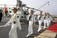 Chinese sailors march in formation on the helipad of the Chinese frigate Yancheng docked at Limassol port, January 4, 2014. REUTERS/Andreas Manolis