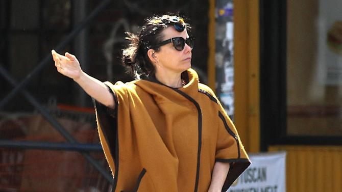 Icelandic singer-songwriter Bjork tries to get a cab in New York City