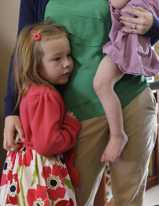 Coy Mathis gets a hug from her mother Kathryn, who holds Coy's sister Auri, 2, at their home in Fountain, Colo., Monday Feb. 25, 2013.  Coy has been diagnosed with Gender Identity Disorder. Biological