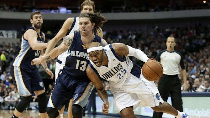 Dallas Mavericks shooting guard Vince Carter (25) drives to the basket past Memphis Grizzlies' Mike Miller (13) as Marc Gasol, left rear, of Spain, and Dirk Nowitzki, right rear, of Germany, watch in the second half of an NBA basketball game Saturday, Nov. 2, 2013, in Dallas. The Mavericks won 111-99